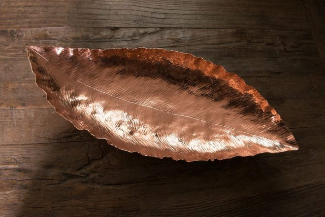 Ben Caldwell's Copper Banana Leaf Bowl. Image via [the artist's website](http://www.benandlael.com/collections/copper-work/products/copper-planished-banana-leaf-bowl).