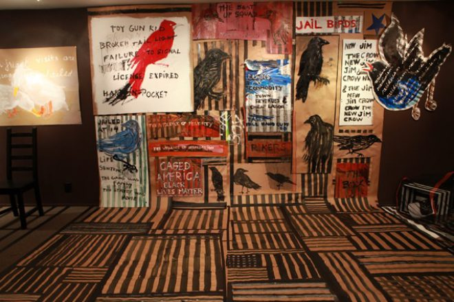 Installation view of _Jail Birds & the New Jim Crow_, 2015, at Greene County Council on the Arts, Catskill, New York. Image via [the artist's website](http://www.henriettamantooth.com/jail-birds2015/).