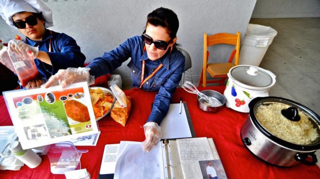 "Karla Diaz and Antonio De Jesus Lopez recreating recipes from _Prison Gourmet_ as part of ""Let them Eat LACMA"" at the Los Angeles County Museum of Art. Courtesy the artists. Image via [VICE](https://www.vice.com/en_us/article/the-art-of-gourmet-cooking-in-prison-511)."