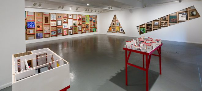 Installation view of Debtfair in a 2015 exhibition at Art League Houston. Image via [Art League Houston's website]( http://www.artleaguehouston.org/past-exhibitions-2015).