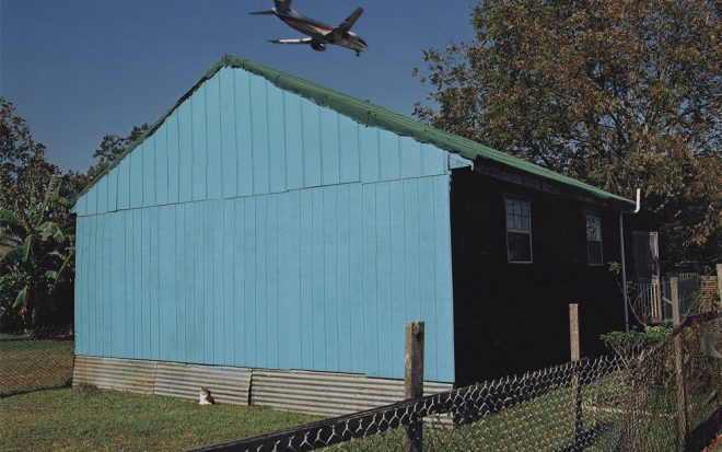 William Greiner, _Jet Over Blue and Black House, Kenner, Louisiana_, 1994. Chromogenic print. Collection of the Ogden Museum of Southern Art.