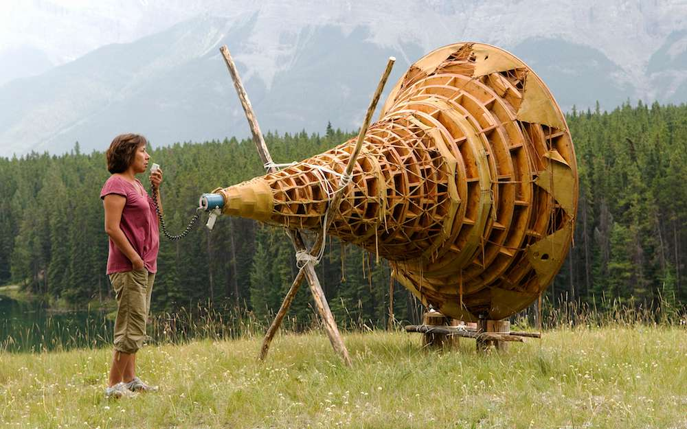 Rebecca Belmore activating her work _Ayum-ee-aawach Oomama-mowan: Speaking to Their Mother_, 1991, at Banff National Park in Alberta, Canada. Courtesy the artist.